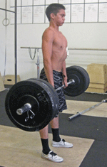 kid doing barbell deadlift