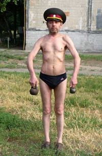 Funny skinny guy with kettlebells