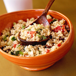 cooked quinoa in orange bowl